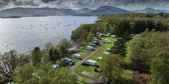 Pitch on the shores of Loch Lomond at Milarrochy Bay campsite, Scotland