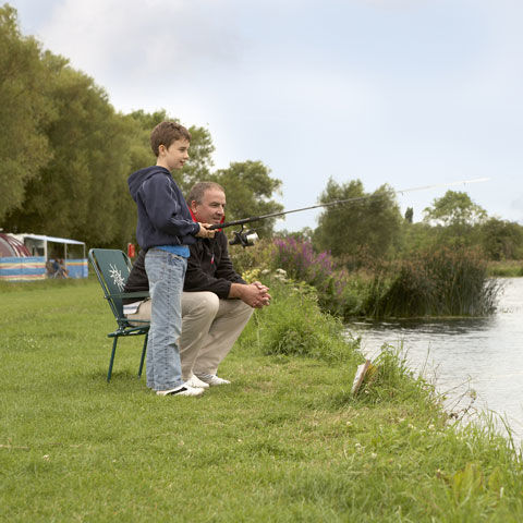 Father and son fishing at Oswestry campsite, camping in Shropshire
