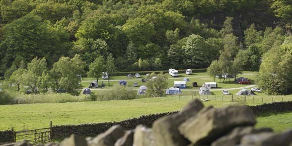 A Family Spending Time Together Exploring the Woods Adjacent to Hayfield Camp Site, campsites in the Peak District