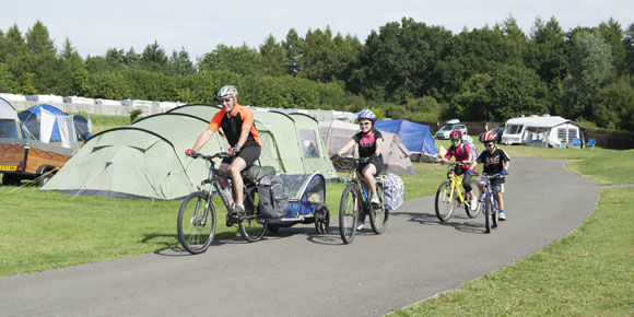 Cycling through the New Forest at Verwood campsite, Campsites in Dorset