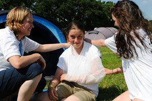 Youth leader teaches first aid to Camping Club Youth members