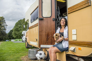 Dog and owner with their motorhome at Wolverley Club Site