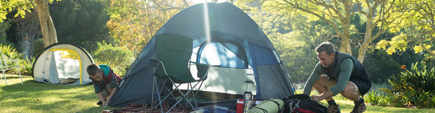 Father and son pitching tent