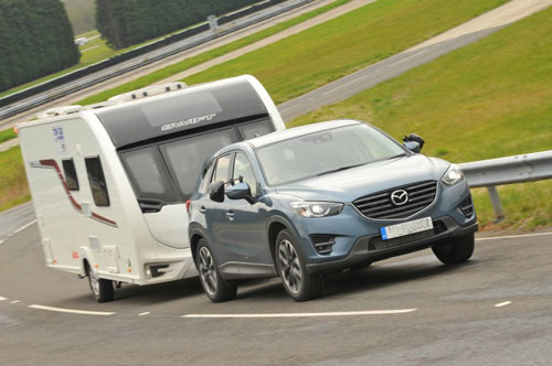grey-car-towing-a-caravan