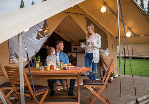 family-enjoying-breakfast-on ready camp decking