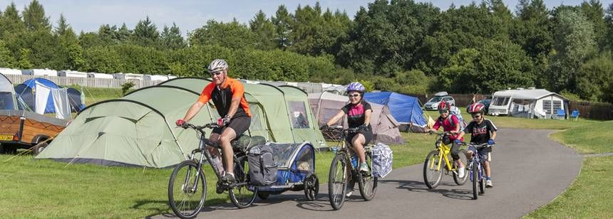 family cycling on verwood campsite