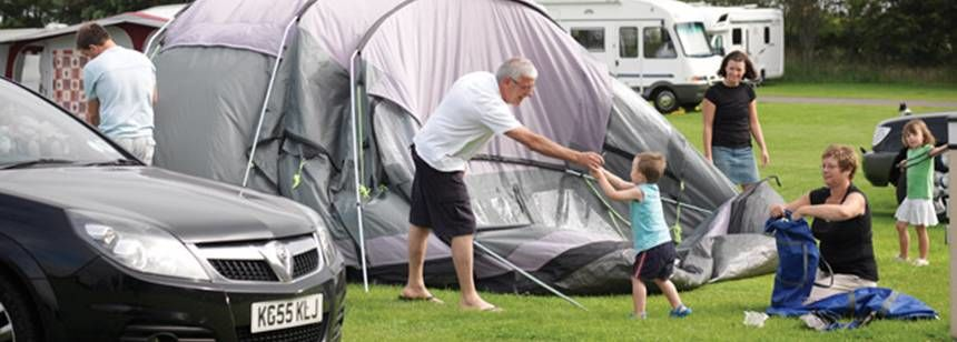 family pitching up on scarborough campsite