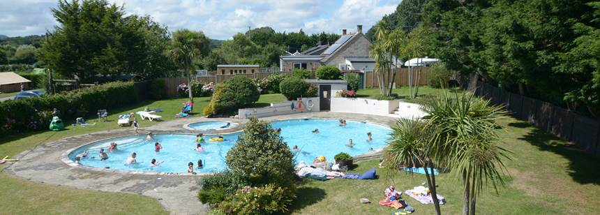 Views of the swimming pool on Adgestone campsite