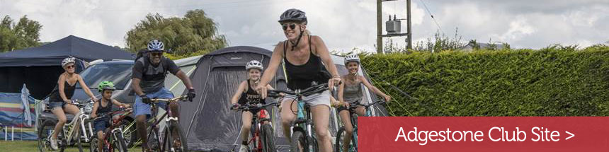 family-cycling-on-adgestone campsite