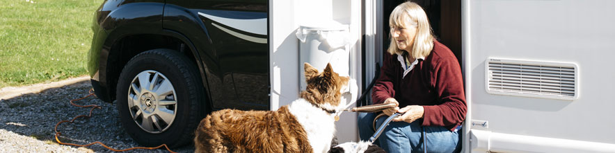lady with dog in motorhome