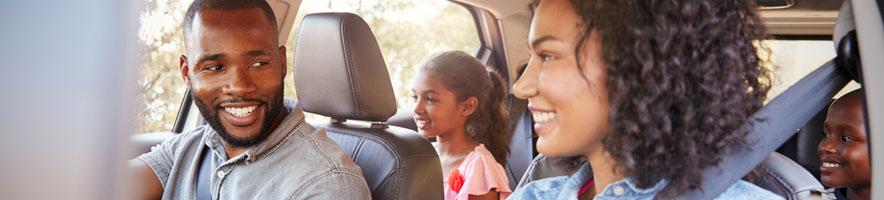 Family in car on road trip (shutterstock, Monkey Business Images)