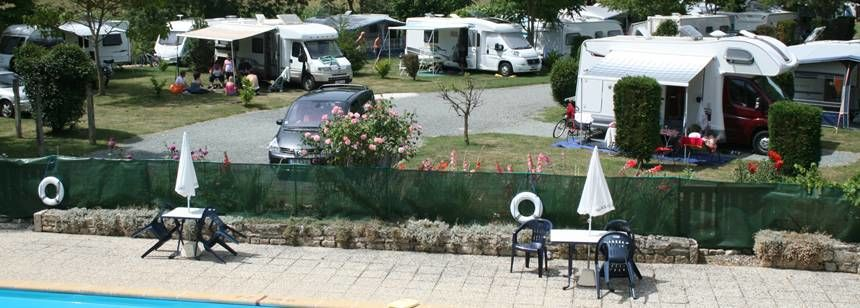 The poolside and pitches at Camping Le Moulin, Deux-Sevres, central France