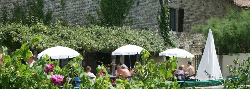 The poolside bar terrace at Camping Le Moulin, Deux-Sevres, central France