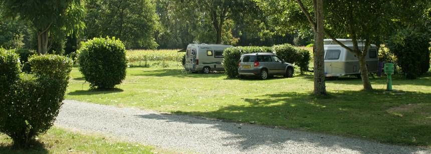 Peaceful pitches bordered by fields at Camping Le Moulin, Deux-Sevres, central France