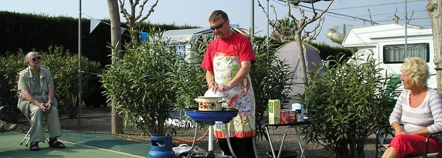 Couples Cooking A Barbeque at the Camping Monmar Campsite, Moncofa Spain