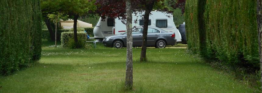 Grassy pitches at Camping Le Jardin de Sully, Sully-sur-Loire, France