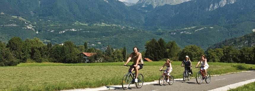 Family Cycling While Staying at La Ravoire Campsite, France