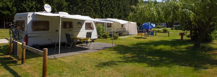 Caravans on pitches at Camping Le Vaubarlet, Auvergne
