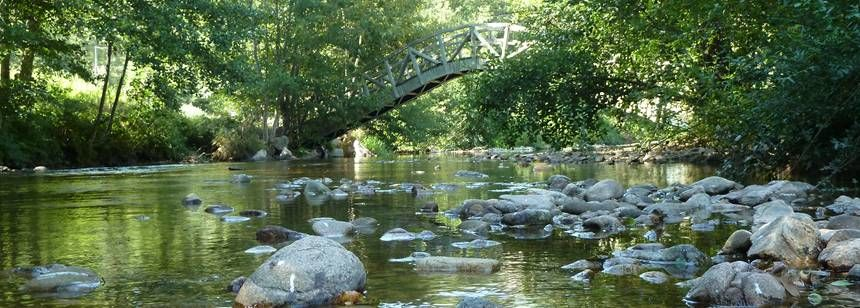 Chinese bridge over River Duniere at Camping Le Vaubarlet, Auvergne
