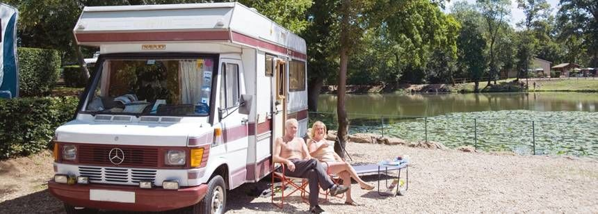 Motorhome on pitch by the lake at Château De L'Epervière Campsite, France