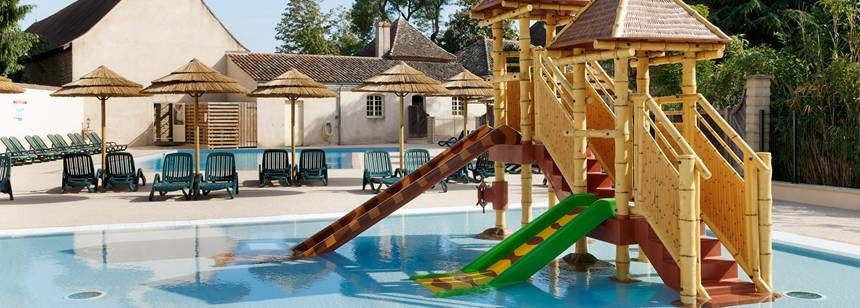 The swimming pool and terrace at  at Camping Chateau de l'Eperviere, Burgundy