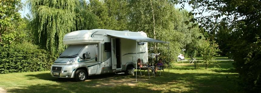 Shaded Grass Pitches With A Motorhome at the Les Ripettes Campsite, France