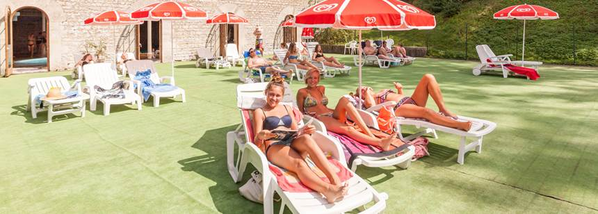 The swimming pool sunbathing terrace Camping La Forge de Sainte-Marie, near Joinville, Champagne-Ardenne, France