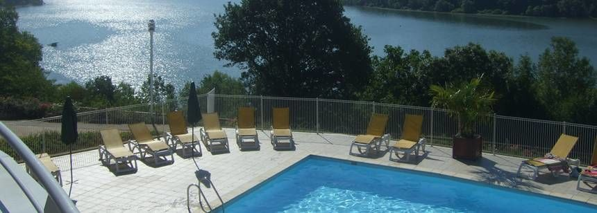 Swimming Pool and Scenic Views at the Lac De La Liez Campsite, France