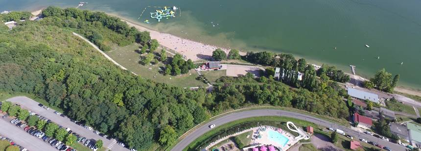 Arial view of Camping Lac de la Liez, Peigney, Champagne, Burgundy, France, with inflatable course on the lake