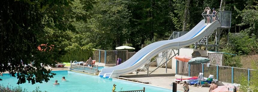 Swimming Pool and Water Slides at the Le Vézère Périgord Campsite, France