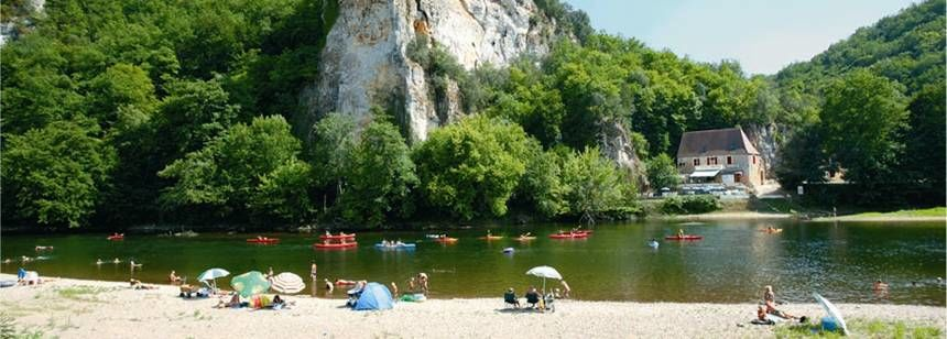 Relaxing on the Dordogne river beach at Camping Soleil Plage