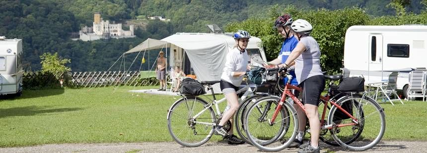 Family Cycling Through the Burg Lahneck Campsite, Germany