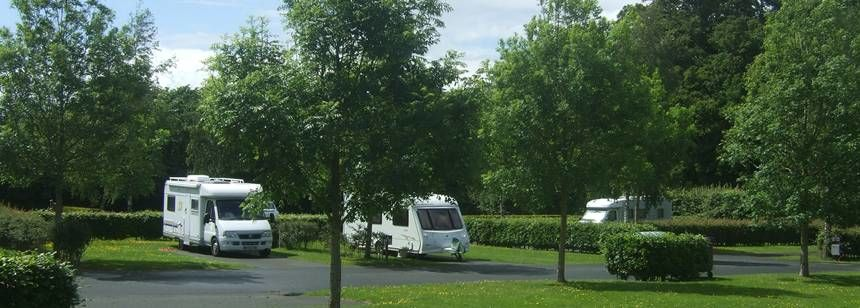 Grass and Hard St and ing Pitches at the Camac Valley Campsite, Irel and