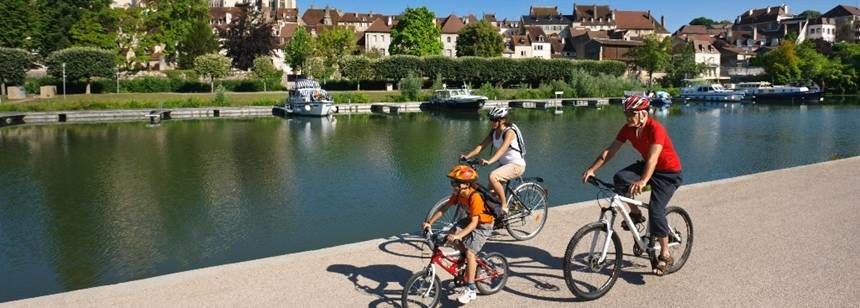 Cycling by the river at Dole, 22km from Camping La Plage Blance, Ounans, France
