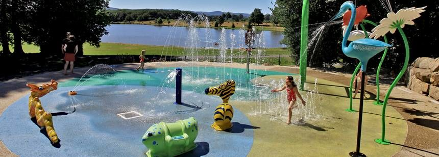 Fun on the splash pad at Camping Chateau de Poinsouze, Limousin
