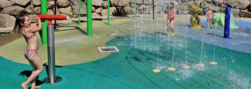 Fun on the splashpad at Camping Chateau de Poinsouze, Limousin