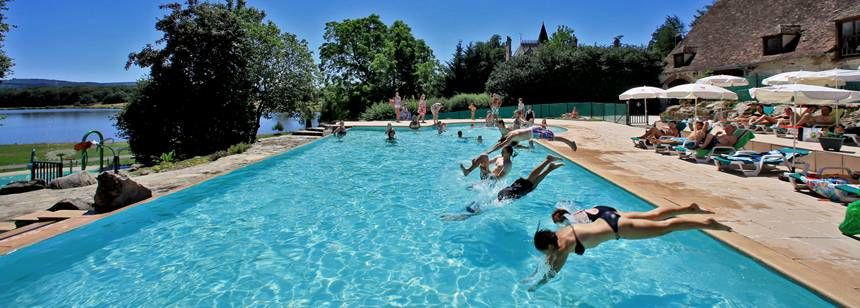 Fun at the swimming pool at Camping Chateau de Poinsouze, Limousin