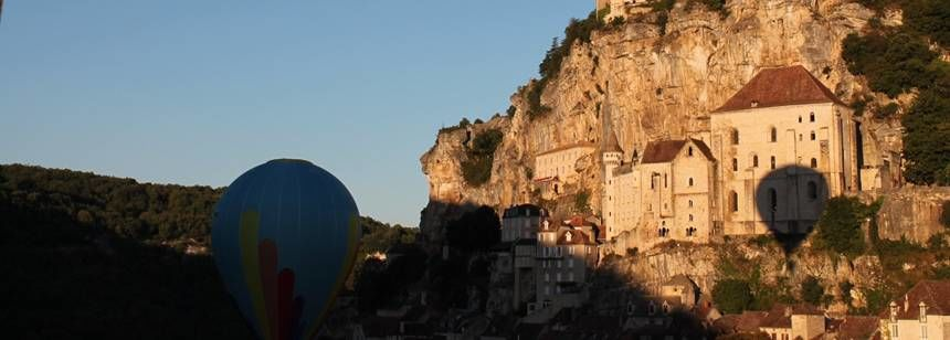 Balloon lifting off at Rocamadour near Château Lacomté in the Lot Valley, France