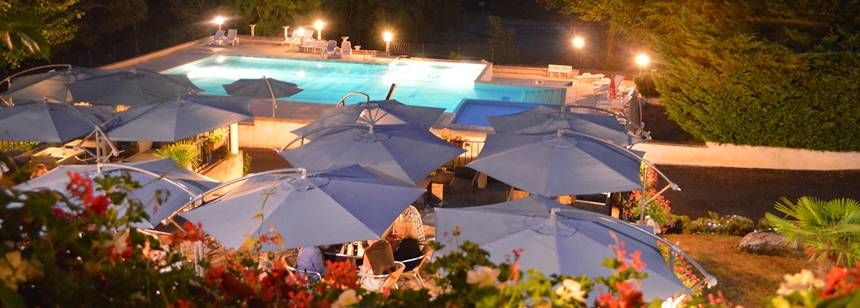 The pool terrace in the evening at Château Lacomté in the Lot Valley, France