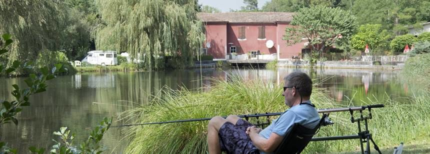 Relaxing On the Banks of the River Beside the Moulin De Campech Campsite, France