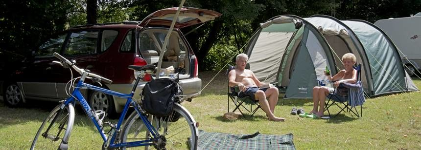 Relaxing Beside Their Tent at the Le Soulhol Campsite, France