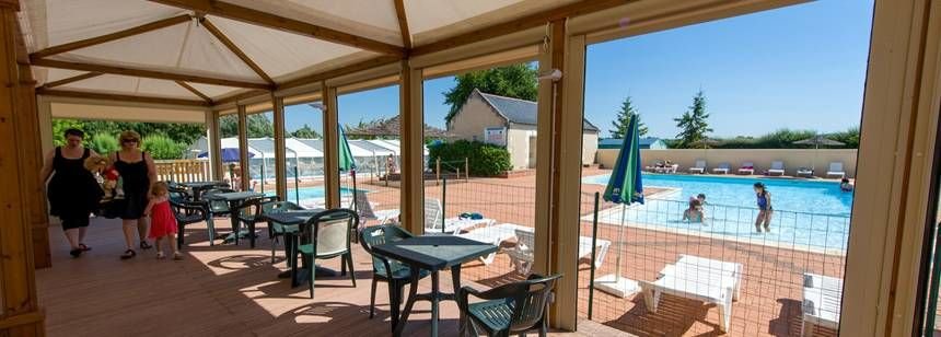 The terrace and pool area at Domaine de l'Etang, Brissac, France.