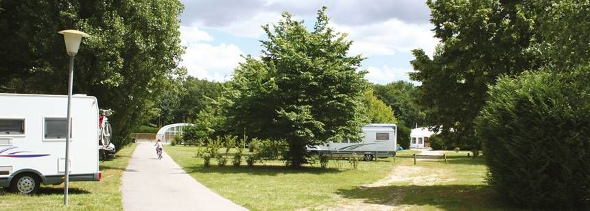 Shaded Grass Pitches at the La Mignardière Campsite, France