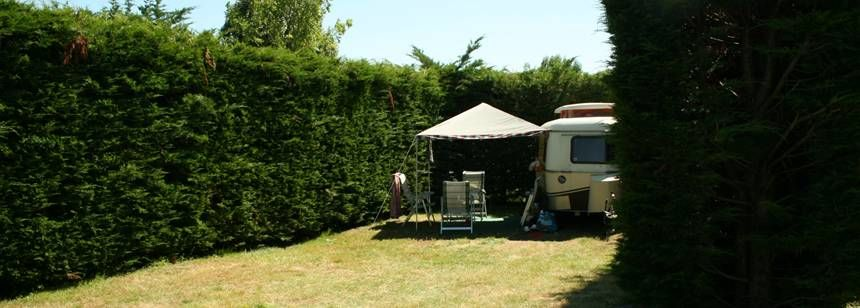 Secluded Grass Pitches at the La Mignardière Campsite, France