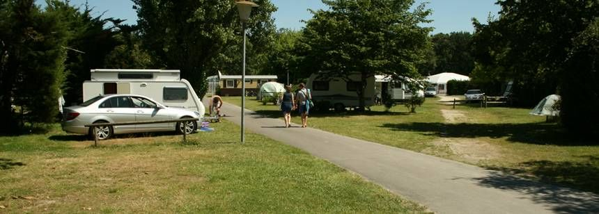 Grass Pitches With Caravan and Motorhome at the La Mignardière Campsite, France