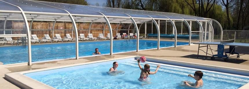 Swimming Pool and Childrens Play Area at the Les Saules Campsite, France