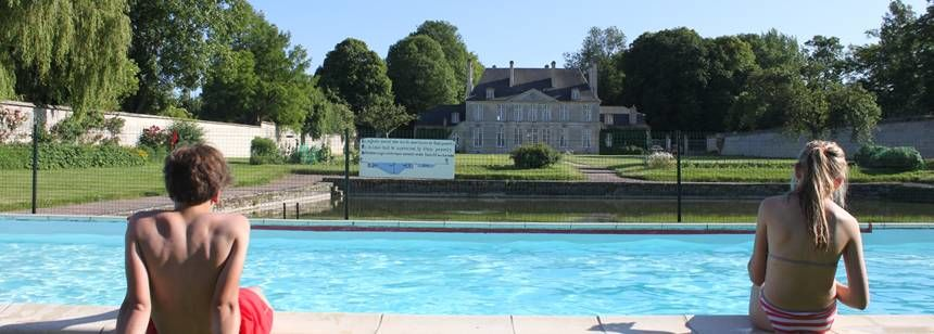Kids Playing in the Swimming Pool at the Château De Martragny Campsite, France