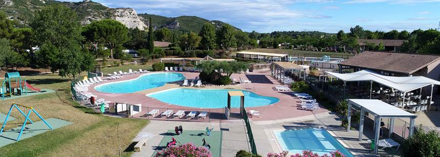 Swimming pools and bar terrace at Camping L'Île des Papes, Provence, France