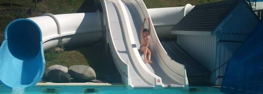 Having fun on the waterslide at at Camping Airotel Pyrénées, France