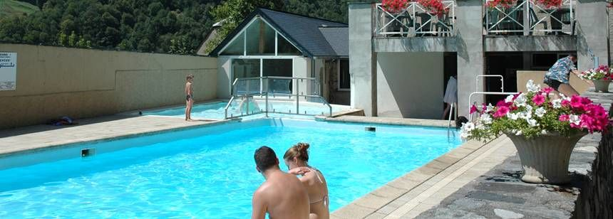 Relaxing by the pool at Camping Airotel Pyrenees, France